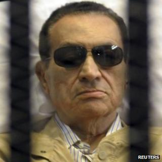 Hosni Mubarak sits inside a cage in a courtroom in Cairo. Photo: 2 June 2012