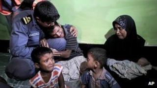 Mohammad Rafique, a Rohingya Muslim from Myanmar begs a border guard to let him and his family stay in Bangladesh