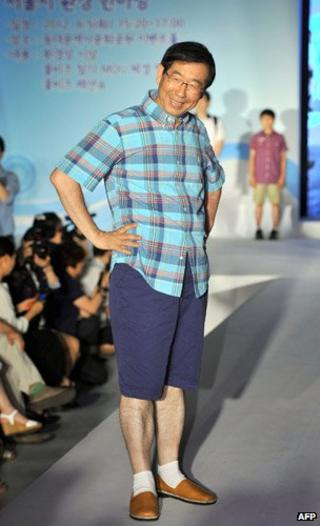Seoul's mayor Park Won-Soon (C) wears shorts on a catwalk to help promote a casual clothing campaign