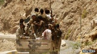 File image of soldiers riding in a military truck in Abyan
