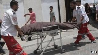 Palestinians wheel the body of 21-year-old Ghaleb Ermilat - who Israel says was a militant - into the al-Najar hospital in Rafah, in the Gaza Strip on Wednesday, following an Israeli air strike on southern Gaza