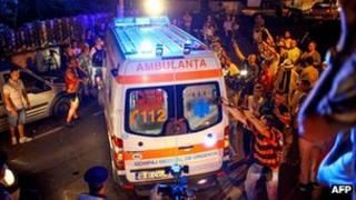 An ambulance carrying former Romanian Prime Minister Adrian Nastase speeds away after he allegedly tried to commit suicide in his house