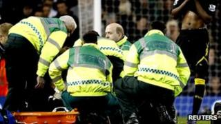 Fabrice Muamba receives treatment on the pitch during the Spurs v Bolton cup tie