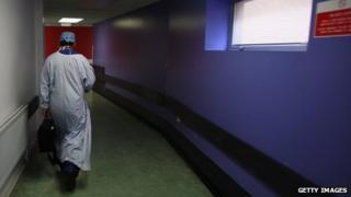 A doctor walking down a corridor