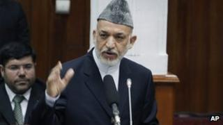 President Hamid Karzai speaks to lawmakers in parliament on Thursday