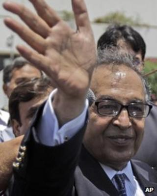 """Makhdoom Shahabuddin, nominated prime minister by the ruling Pakistan People""""s party, waves after filing his candidacy paper at the Parliament, in Islamabad, Pakistan, Thursday, June 21, 2012."""