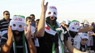 People demonstrating against Syria's President Bashar al-Assad outside the Syrian embassy in Amman June 21, 2012