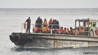 A barge carrying rescued suspected asylum seekers nears Christmas Island on 22 June