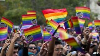 People mark the International Day against Homophobia in Santiago on 12 May 2012