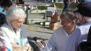 Tony Vale interviewing a couple celebrating their 60th wedding anniversary, who were guests at the Wymondham Diamond Jubilee celebrations
