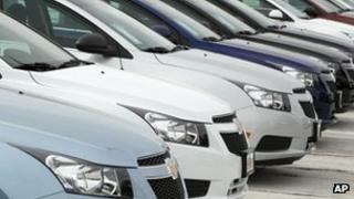 Line of Chevrolet Cruze cars at a dealership in Englewood, Colorado 19 February 2012