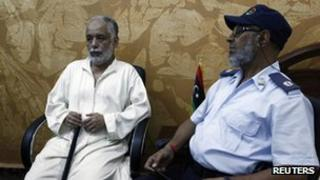 Deposed Libyan leader Muammar Gaddafi's former prime minister al-Baghdadi al-Mahmoudi sits in the office of his prison guard in Tripoli after being extradited from Tunis on June 24
