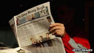 A man reads the Sydney Morning Herald newspaper on 20 June, 2012 in Sydney, Australia