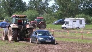 Vehicles being pulled out of mud