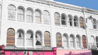 Restored shop front signs in St Leonards