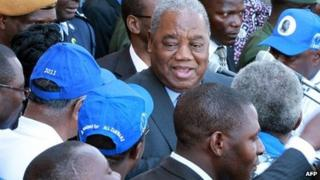 A picture taken on 10 August 2011 shows Zambia's ex-President Rupiah Banda (C) addressing MMD supporters