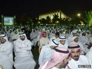 Kuwaiti men attend a protest in Kuwait City's Erada square (26 June 2012)