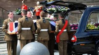 Pallbearers with Cpl Thacker's coffin