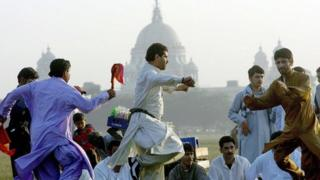 Afghans dancing in front of the Victoria memorial in India.