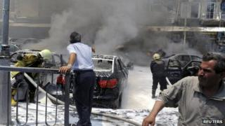 Picture released by Sana news agency showing the aftermath of explosions outside a court complex in Damascus (28 Jun 2012)