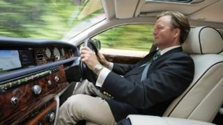 Our reporter driving a Rolls Royce Phantom up the Goodwood Hill Climb