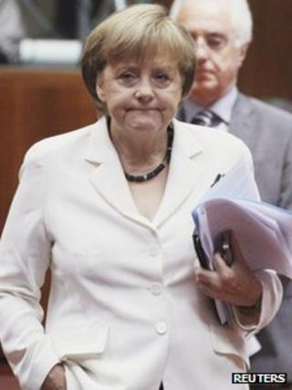 Germany's Chancellor Angela Merkel arrives to attend an European Union leaders' summit in Brussels, 29 June 2012