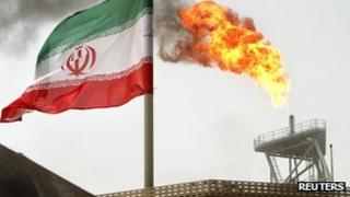 Iranian flag and oil platform