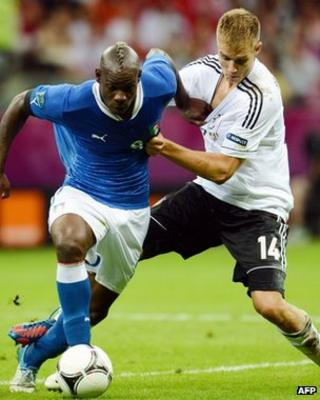 Italy's Balotelli and Germany's Badstuber in Euro 2012 semi-final