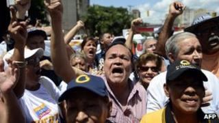 People demonstrate in support of Globovision outside the court in Caracas