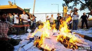 Protesters burn ballot papers and other election materials outside the High National Election Commission's office in Benghazi on 1 July 2012