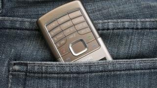Mobile phone in pocket