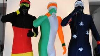 Three people in morphsuits
