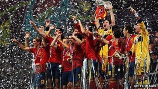 Iker Casillas of Spain lifts the trophy as he celebrates following victory in Euro 2012