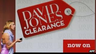Woman walks past David Jones shop