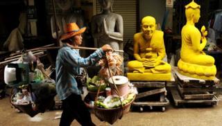 Man walks in backstreets of Bangkok