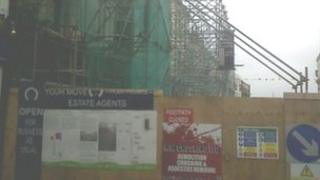 Scaffolding now covers the building
