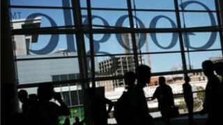 Google logo seen through a window