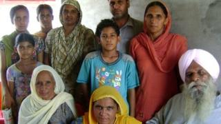 Surjeet Singh (extreme right) at home with his family