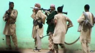 Still from a video shows armed Islamists patrolling in the streets of Gao on 27 June 2012