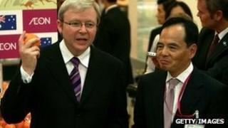 Ex Australian prime minister Kevin Rudd and Aeon CEO Motoya Okada