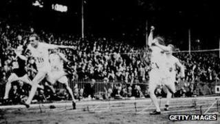 Harold Abrahams crosses the line to win the 100m at the 1924 Olympic Games in Paris.