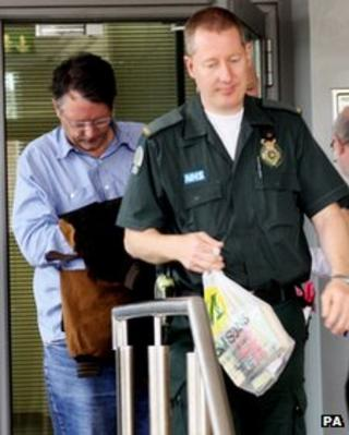 The Earl of Cardigan is escorted to an ambulance waiting outside Salisbury Magistrates' Court