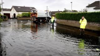 Workers tackle floods