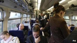 Passengers on crowded train