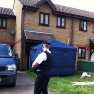 Police officer outside the Stratford house