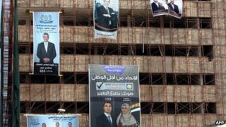 Electoral campaign posters hang from a building under construction on 4 July 2012 in the Libyan capital Tripoli