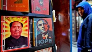 Notebooks printed with portraits of late Chinese Communist leader Mao Zedong (L) and acting president of the United States Barack Obama