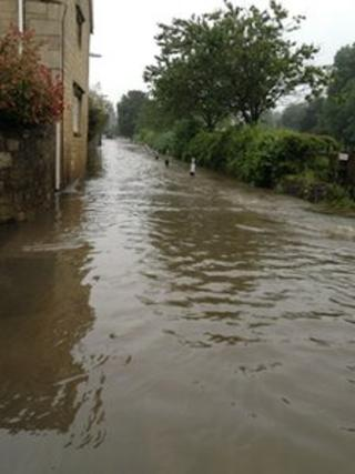 Water covering the main road in Brookhouse near Rotherham