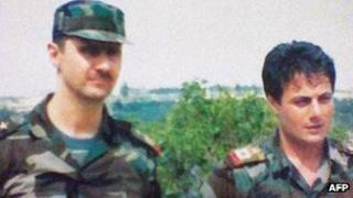Syrian President Bashar al-Assad (left) and Manaf Tlas. File photo