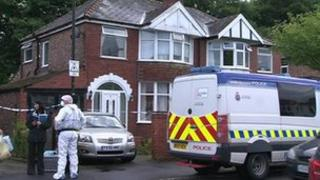Forensic officers at a house in Sale
